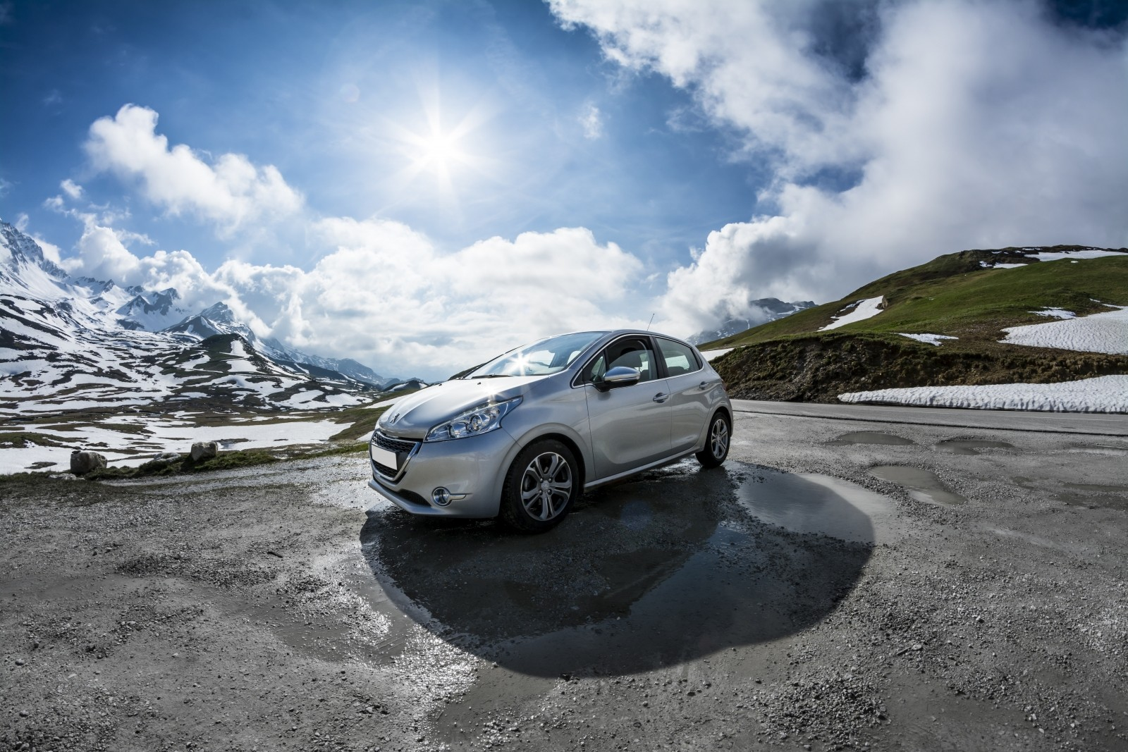 peugeot-208-car-mountain-view-blue-white-spring